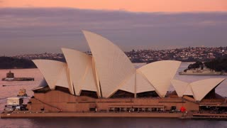 The Sydney Opera House twilight sunset is located near Circular Quay, a harbour in Sydney, New South Wales, Australia on the northern edge of the Sydney central business district on Sydney Cove