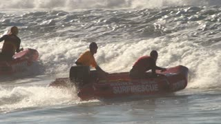 A Surf life saving lifeguard is a rescuer who supervises the safety and rescue of swimmers