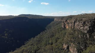 Aerial Australia drone footage of forest valley escarpment and cliffs