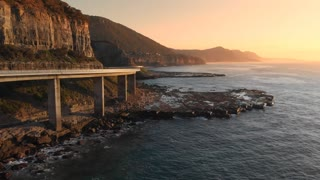 Aerial footage Australia sea cliff bridge coastal drive sunrise coastal seascape