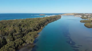 Aerial of river wetlands mangrove forest along coastal NSW Australia