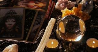 Astrologist soothsayer medium tarot card reading with crystal ball