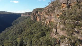 Australia aerial drone footage of forest escarpment and cliffs
