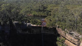 Australia aerial footage of outback river in forest canyon