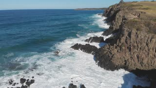 Australia Aerial view of ocean waves crashing on rocky coastline