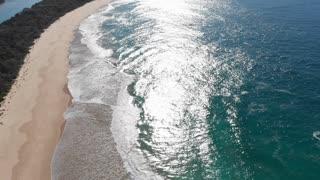 Australia beach seascape from the air waves breaking along coast