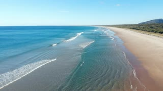 Australia beach seascape waves on deserted sandy beach