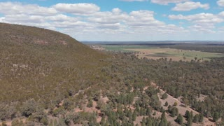 Australia dry outback rural farming and forested landscape Aerial footage