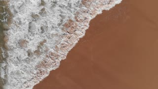 Beach aerial top view waves breaking on beach beautiful seascape Australia