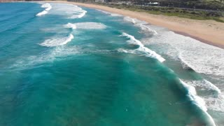 Beach aerial top view waves breaking on beach beautiful seascape Australia