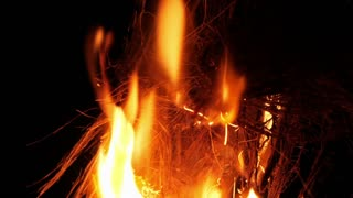 Bush fire arson igniting wood tinder with cigarette lighter