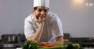 Chef preparing fine dining cuisine in professional restaurant cafe
