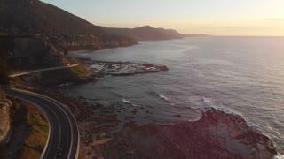 Coastal seascape Sea Cliff Bridge Wollongong NSW aerial footage Australia