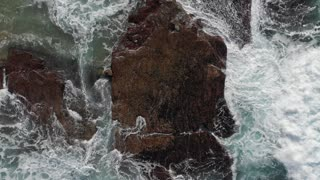 Coastline view and waves crashing on rocky shoreline Australia Aerial