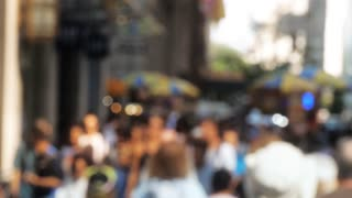 Commuters walking down busy city street people on sidewalk