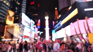 Crowd of people Times Square At Night out of focus New York City