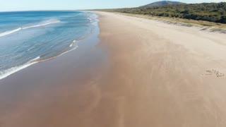Deserted sandy beach aerial drone footage ocean seascape