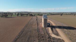 Dry drought effected rural agriculture farm with silo Australia - Aerial