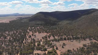 Dry outback Australia aerial drone footage rural farmland and forested landscape
