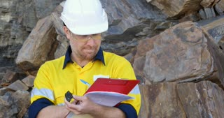 Geochemist Geologist taking field notes about geology in mineral exploration