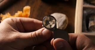Geologist studying Geoscience Geochemistry Examines Rock Minerals