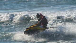 Jetski beach surf lifeguard rescue boat over waves