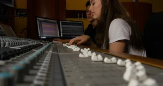 Low angle of recording studio mixing desk using faders