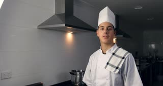 Male Chef cook working in hospitality industry kitchen