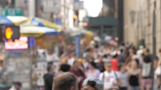 NYC street anonymous pedestrian busy crowds of people walking