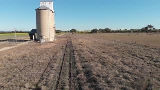 Old grain silo rural Australia agriculture farming landscape Aerial footage