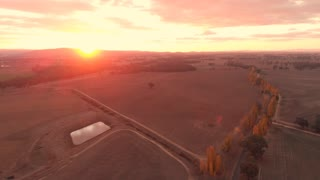 Outback farm country Australia sunset aerial drone footage