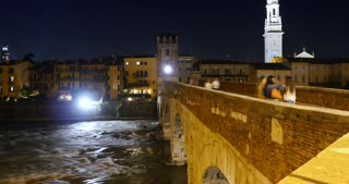 Ponte Pietra, Verona city on Adige river in Veneto, Italy - timelapse night