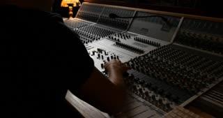 Recording music studio engineer mixing board sound desk in recording studio