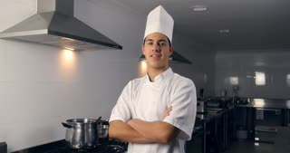 Smiling young chef portrait working as a professional cook