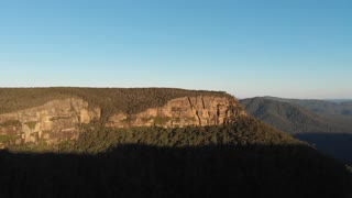 Sunset Aerial Australia drone footage of forest escarpment and cliffs