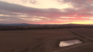 Sunset Aerial of outback Australia rural countryside farmland