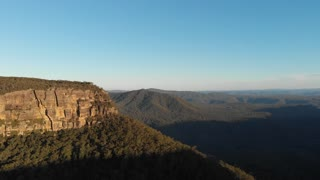 Sunset view aerial Australia drone footage of forest escarpment and cliffs