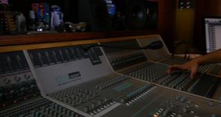 Teaching audio recording desk console in recording studio for sound mixing