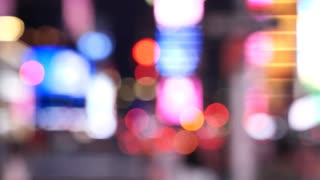 Times Square At Night out of focus billboard and lights, New York City