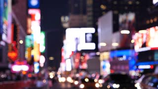 Times Square At Night out of focus traffic, billboard and lights, New York City