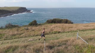 Trail running cross-country healthy lifestyle athlete training with dog