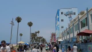 VENICE BEACH, LOS ANGELES, CALIFORNIA - CIRCA 2018: People walking slow-mo