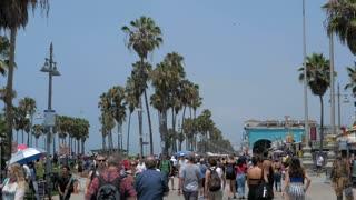 VENICE BEACH, LOS ANGELES, CALIFORNIA - CIRCA 2018: People walking slow motion