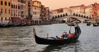Venice Italy - gondola on canal with tourists