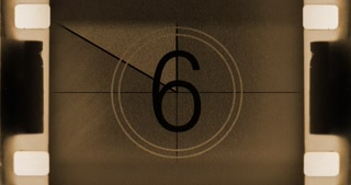 Vintage film leader countdown with light leaks and scratches