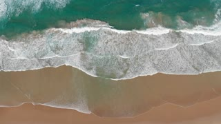 Waves breaking aerial top view beautiful beach seascape Australia