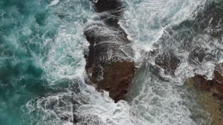 Waves breaking aerial top views breaking beautiful seascape Australia