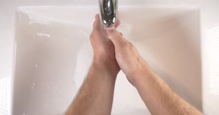 Washing hands in sink with soap to clean skin for good hygiene