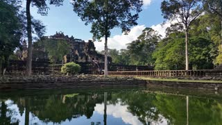 Water reflection Angkor Thom Cambodia ancient stone ruin temple