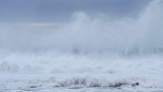 White wash from stormy seas creating big waves crashing slow-mo